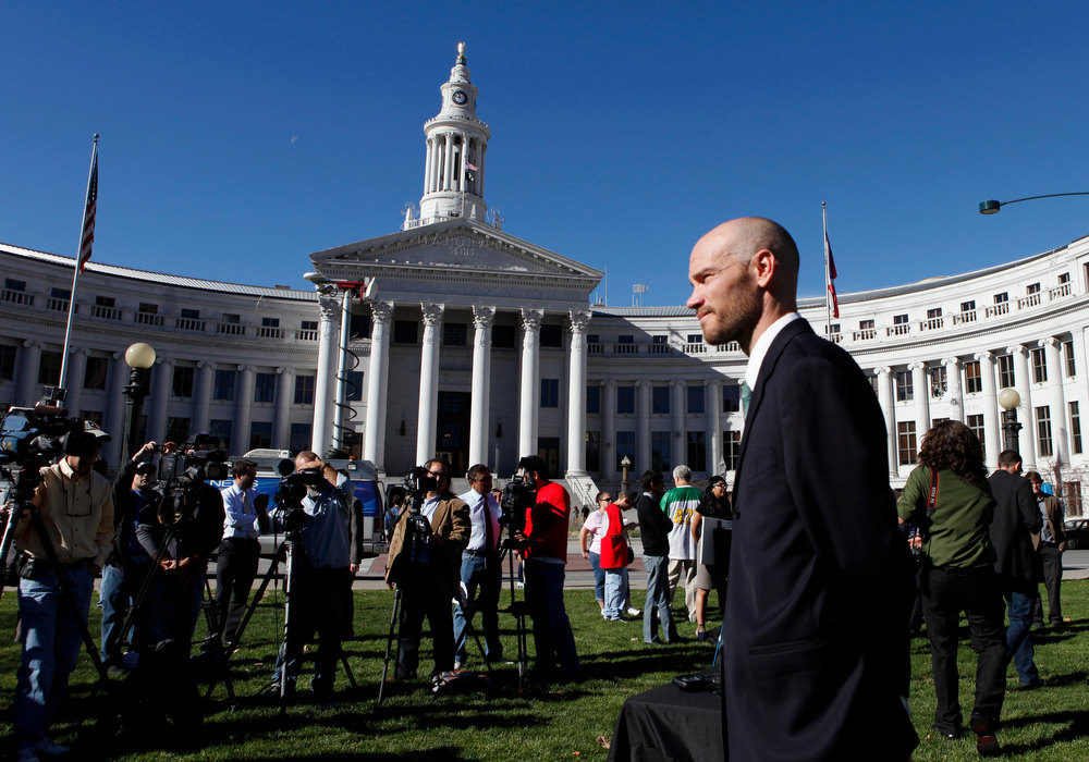 Description of . Brian Vicente co-director of the Yes on 64 campaign waits to start a news conference about the legalization of marijuana at Civic Center Park in Denver on Wednesday, Nov. 7, 2012.  Colorado voters passed Amendment 64 on Tuesday legalizing marijuana in Colorado for recreational use. (AP Photo/Ed Andrieski)