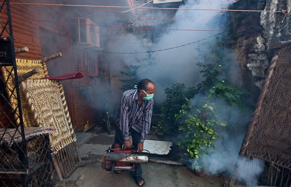 . In this picture taken on October 3, 2013, an Indian Municipal health worker fumigates against mosquitoes at a neighborhood in New Delhi. Dengue fever is a mosquito-borne disease with no known cure or vaccination that strikes fear into the citizens of New Delhi when it arrives with the monsoon rains -- just as the scorching heat of the summer is subsiding.  MANAN VATSYAYANA/AFP/Getty Images