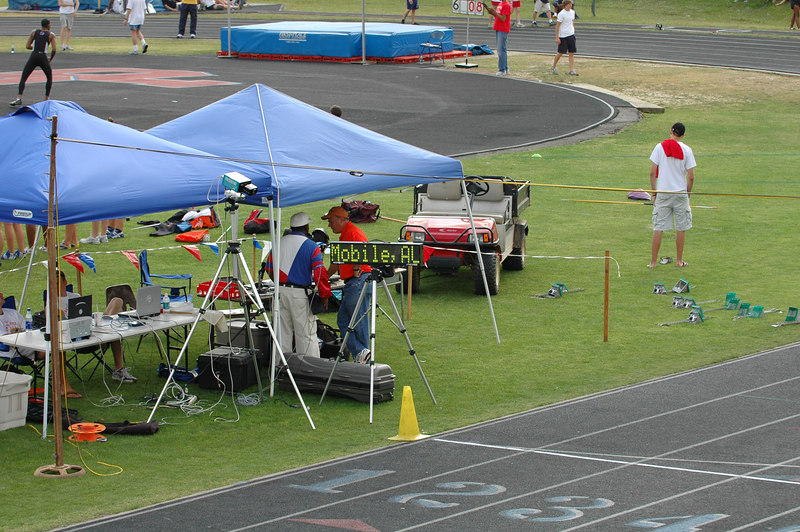 Timing tent looks about ready. It must be, otherwise Steve Dibari wouldn't be standing over there with his hands in his pockets. Note the boys' HJ bar is at 6'8. Three competitors cleared that, with Donte Nall winning with a meet record 7'0.
