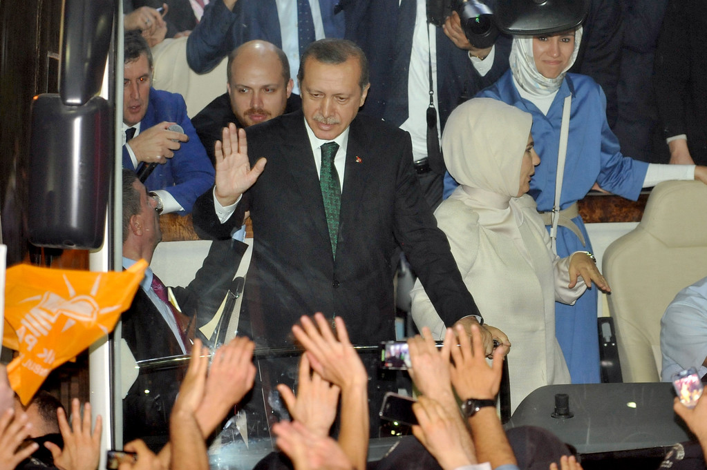 ". Turkish Prime Minister Recep Tayyip Erdogan (L),  wife Emne Erdogan (C) and daugther Sumeye Erdogan (R) are greeted by supporters upon arrival at Ataturk International Airport in Istanbul on June 7, 2013.Turkey\'s Islamic-rooted government apologised to wounded protestors and said it had ""learnt its lesson\"" after days of mass street demonstrations that have posed the biggest challenge to Prime Minister Recep Tayyip Erdogan\'s decade in office. Turkish police had on June 1 begun pulling out of Istanbul\'s iconic Taksim Square, after a second day of violent clashes between protesters and police over a controversial development project. What started as an outcry against a local development project has snowballed into widespread anger against what critics say is the government\'s increasingly conservative and authoritarian agenda.  OZAN KOSE/AFP/Getty Images"