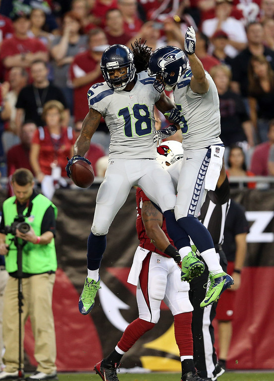 . GLENDALE, AZ - OCTOBER 17: Wide receiver Sidney Rice #18 of the Seattle Seahawks celebrates a touchdown in the first quarter against the Arizona Cardinals during a game at the University of Phoenix Stadium on October 17, 2013 in Glendale, Arizona.  (Photo by Christian Petersen/Getty Images)