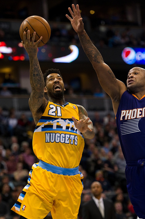 . DENVER, CO - DECEMBER 20: Wilson Chandler #21 of the Denver Nuggets shoots against P.J Tucker #17 of the Phoenix Suns during the at the Pepsi Center on December 20, 2013, in Denver, Colorado. (Photo by Daniel Petty/The Denver Post)