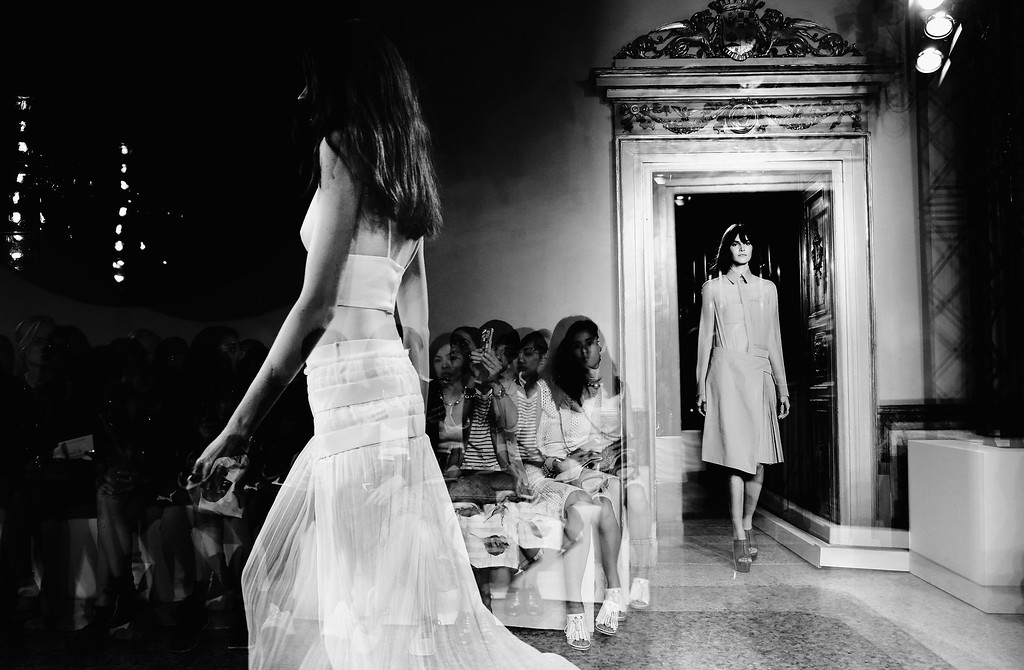 . (EDITORS NOTE: Image has been converted to black and white.) A model walks the runway during the Ports1961 show as a part of Milan Fashion Week Womenswear Spring/Summer 2015 on September 18, 2014 in Milan, Italy.  (Photo by Vittorio Zunino Celotto/Getty Images)