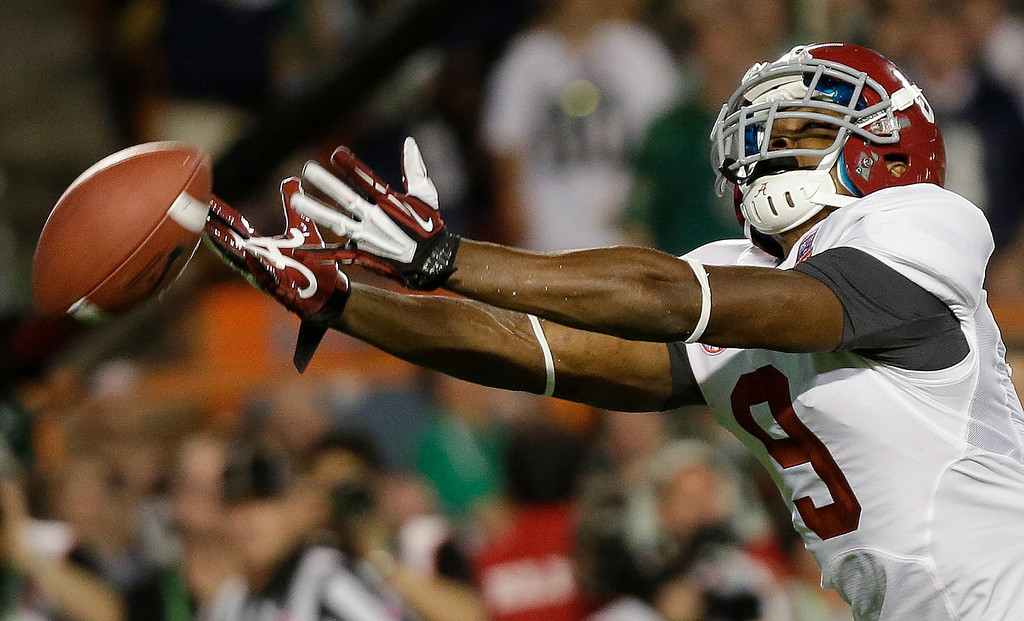 . Alabama wide receiver Amari Cooper can\'t quite come up with a reception during the first half of the BCS National Championship college football game against Notre Dame Monday, Jan. 7, 2013, in Miami. (AP Photo/David J. Phillip)
