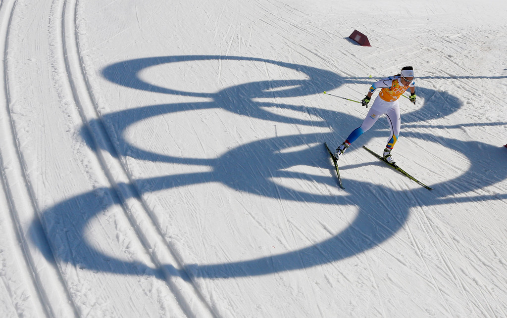 . Sweden\'s Anna Haag skis past the Olympic rings during the women\'s 4x5K cross-country relay at the 2014 Winter Olympics, Saturday, Feb. 15, 2014, in Krasnaya Polyana, Russia. (AP Photo/Dmitry Lovetsky)
