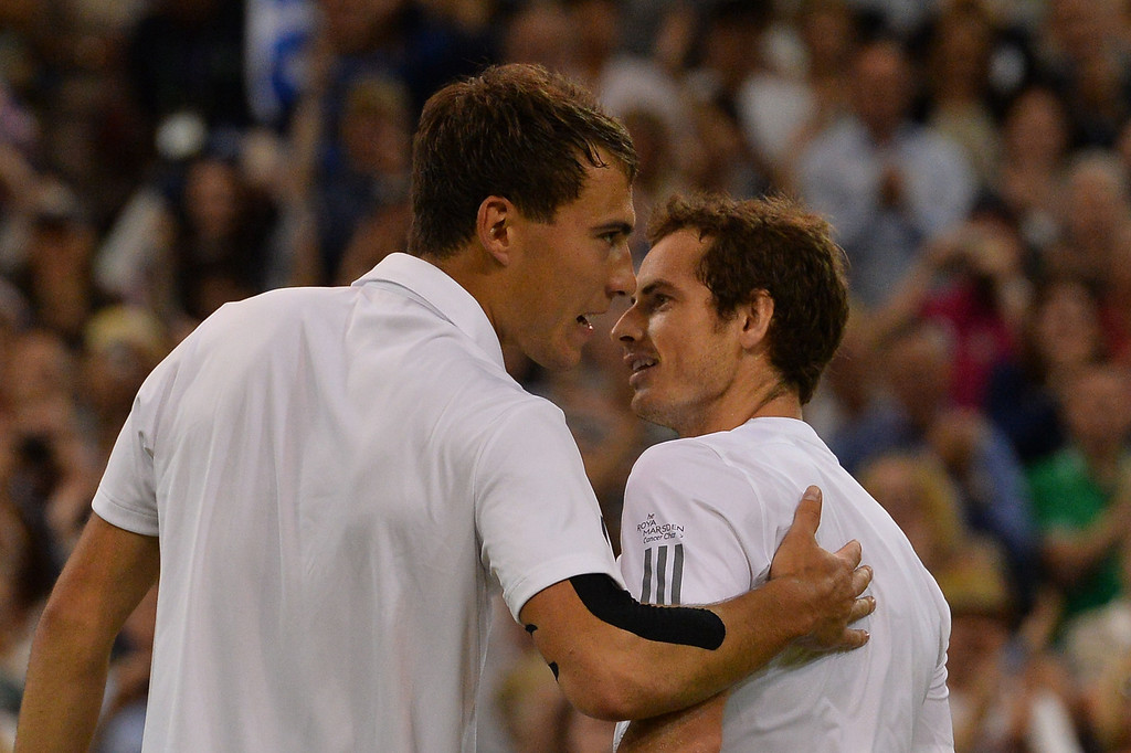 . Britain\'s Andy Murray (R) shakes hands with Poland\'s Jerzy Janowicz (L) after Murray\'s victory in their men\'s singles semi-final match on day eleven of the 2013 Wimbledon Championships tennis tournament at the All England Club in Wimbledon, southwest London, on July 5, 2013. Murray won 6-7, 6-4, 6-4, 6-3. CARL COURT/AFP/Getty Images