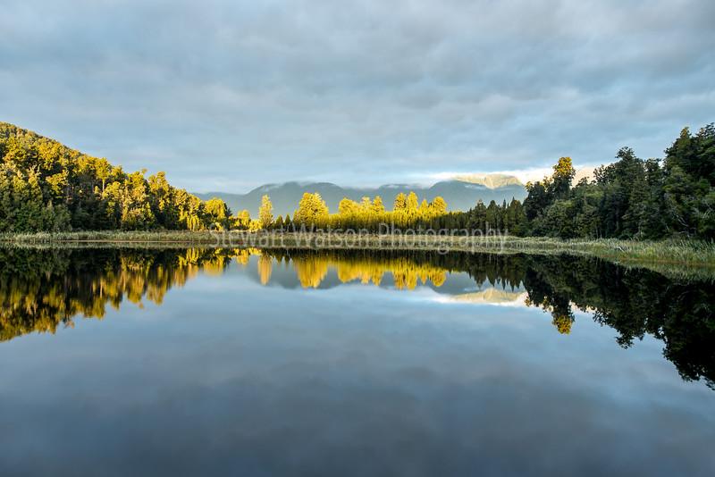 Cloudy Lake Matheson hiding the Alps