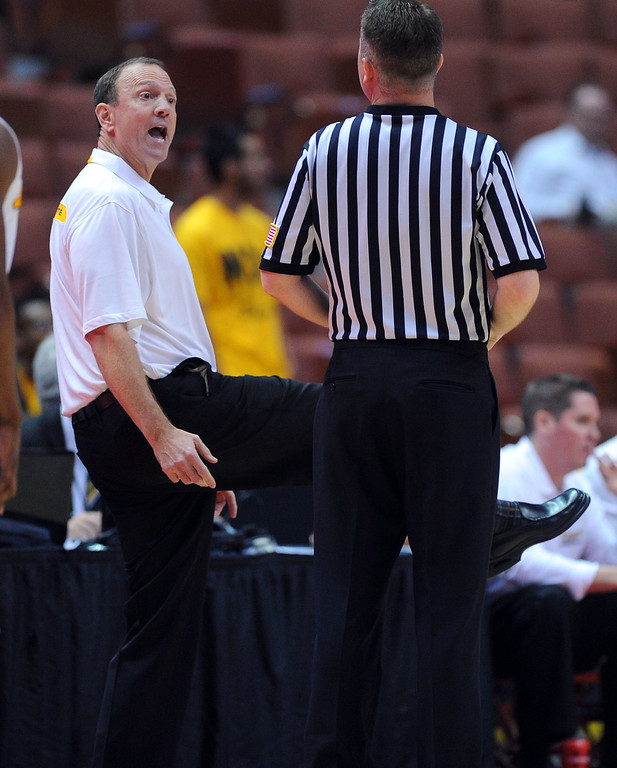 . LBSU coach Dan Monson argues a call with a ref at the Honda Center in Anaheim, CA on Thursday, March 13, 2014. Long Beach State vs CSU Fullerton in the Big West men\'s basketball tournament. 1st half. LBSU won 66-56.  Photo by Scott Varley, Daily Breeze)