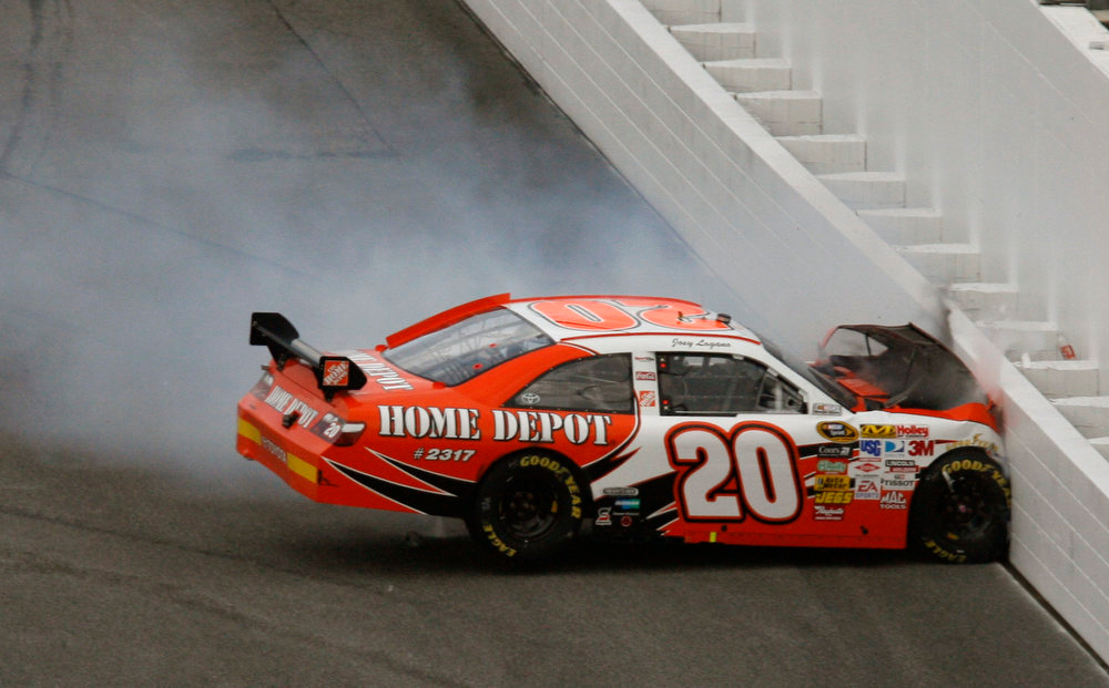 . Joey Logano crashes during the NASCAR Daytona 500 auto race at Daytona International Speedway in Daytona Beach, Fla., Sunday, Feb. 15, 2009. (AP Photo/Glenn Smith)