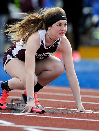 4/5/2018 Mike Orazzi   Staff Bristol Central's Julia Simpson in the 4x100 relay at Plainville High School Thursday afternoon.