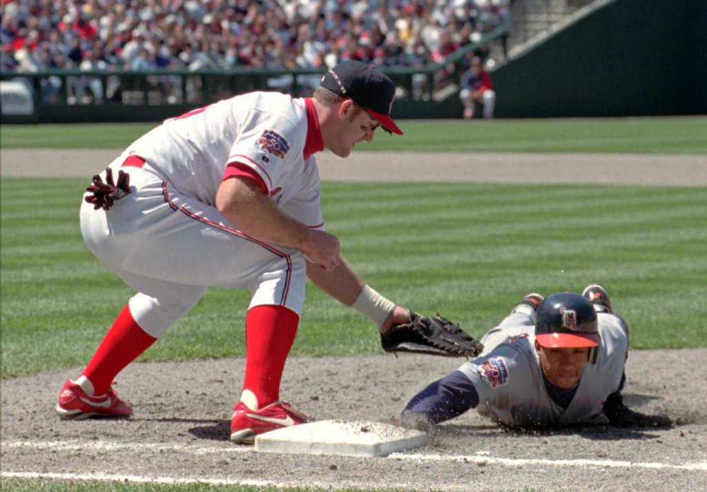 . Cleveland Indians first baseman Jim Thome puts the tag for the out on Detroit Tigers\' Jody Reed, who overran the bag after a single to center field during the fourth inning in Cleveland on Sunday, May 4, 1997. Detroit won 2-0. (AP Photo/Anthony Onchak)