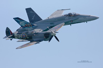 Canadian International Airshow 2008 Heritage Flight.  CF-18 Hornet and RAF Spitfire.  Spitfire flown by Rick Volker.