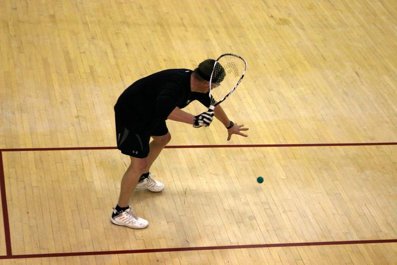 Jason Olsen serving in his Men's B 1st round match..