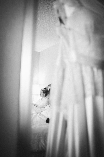 bride reflected in mirror with dress