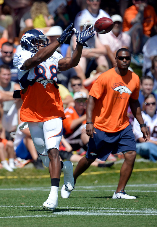 . Denver Broncos WR Demaryius Thomas (88) catches a pass during training camp August 5, 2013 at Dove Valley. (Photo By John Leyba/The Denver Post)