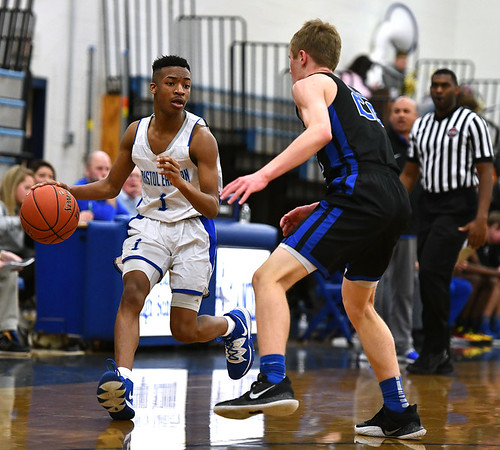 2/18/2020 Mike Orazzi | Staff Bristol Eastern High School's Nasir Walker (1) and Tolland's Max Bos (22) in Bristol on Tuesday night.