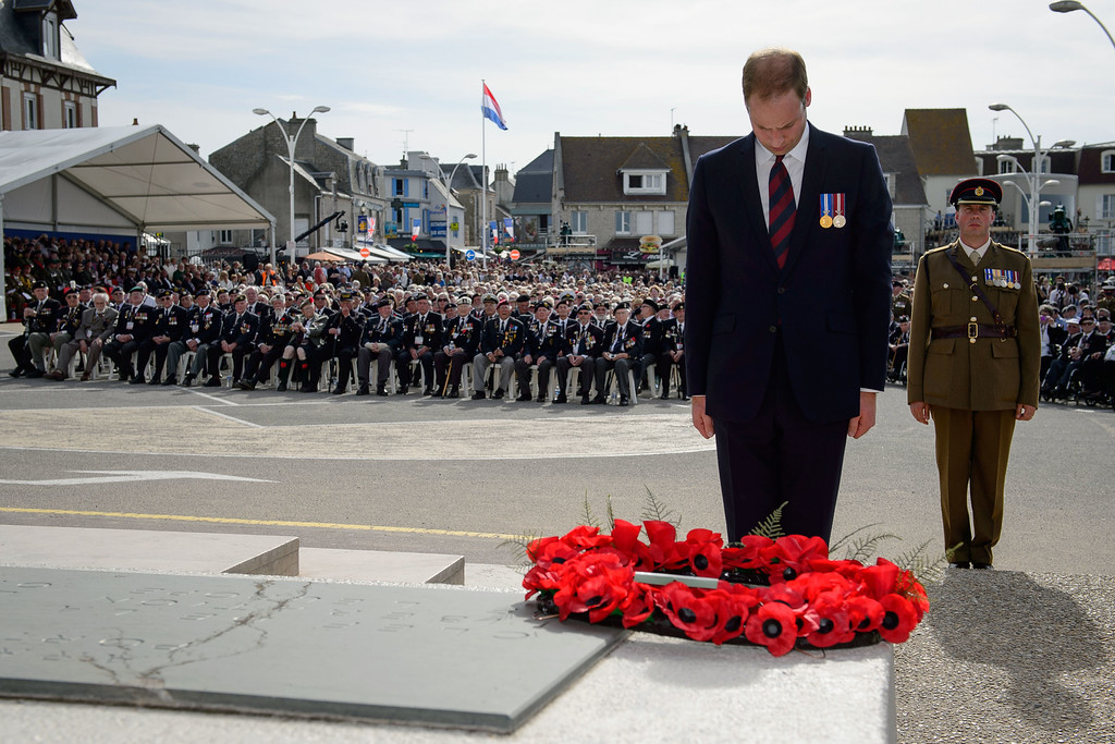 . Britain\'s Prince William, Duke of Cambridge, lays a wreath at an event for veterans in Arromanches-les-Bains, western France, Friday, June 6, 2014, marking the 70th anniversary of the World War II Allied landings in Normandy.  (AP Photo/Leon Neal, Pool)