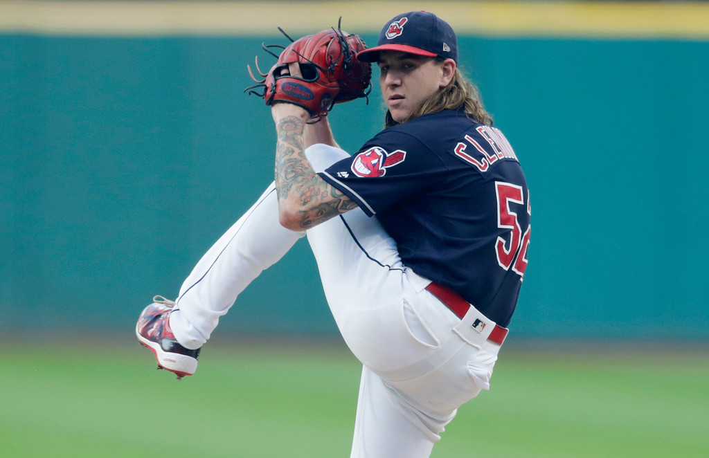 . Cleveland Indians starting pitcher Mike Clevinger winds up during the first inning of the team\'s baseball game against the Kansas City Royals, Tuesday, Sept. 4, 2018, in Cleveland. (AP Photo/Tony Dejak)