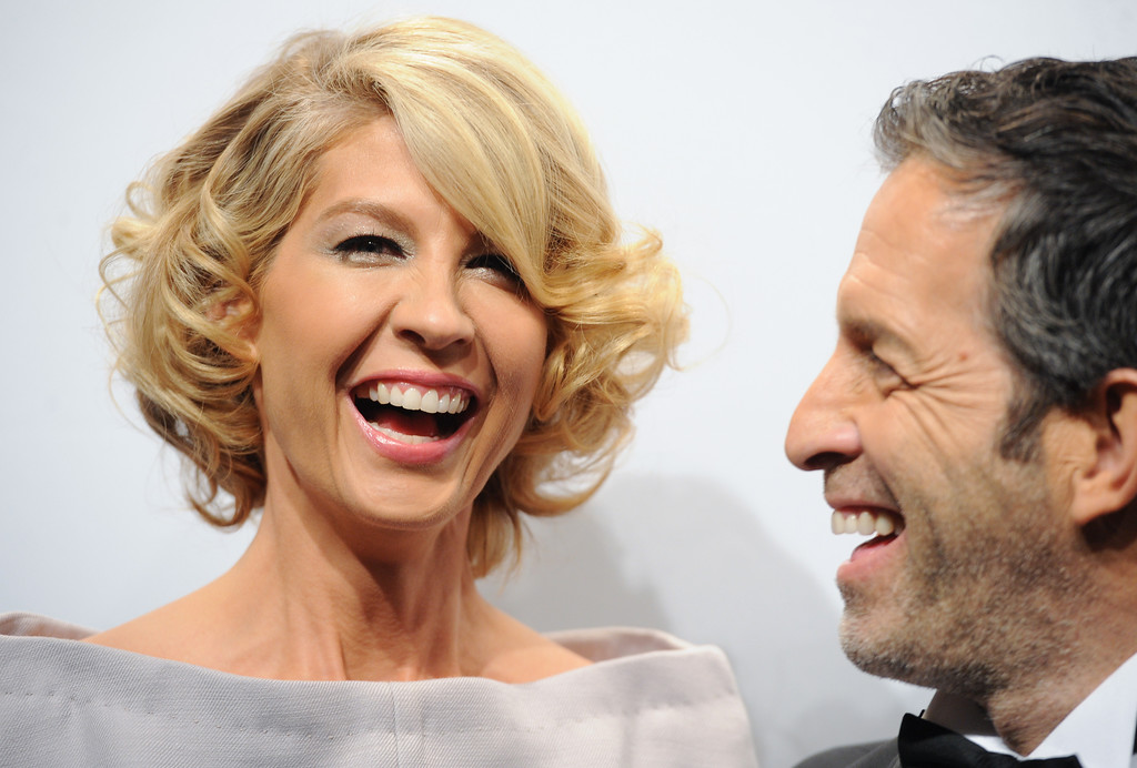 . Actress Jenna Elfman and designer Kenneth Cole attend amfAR\'s New York gala at Cipriani Wall Street on Wednesday, Feb. 6, 2013 in New York. (Photo by Evan Agostini/Invision/AP)