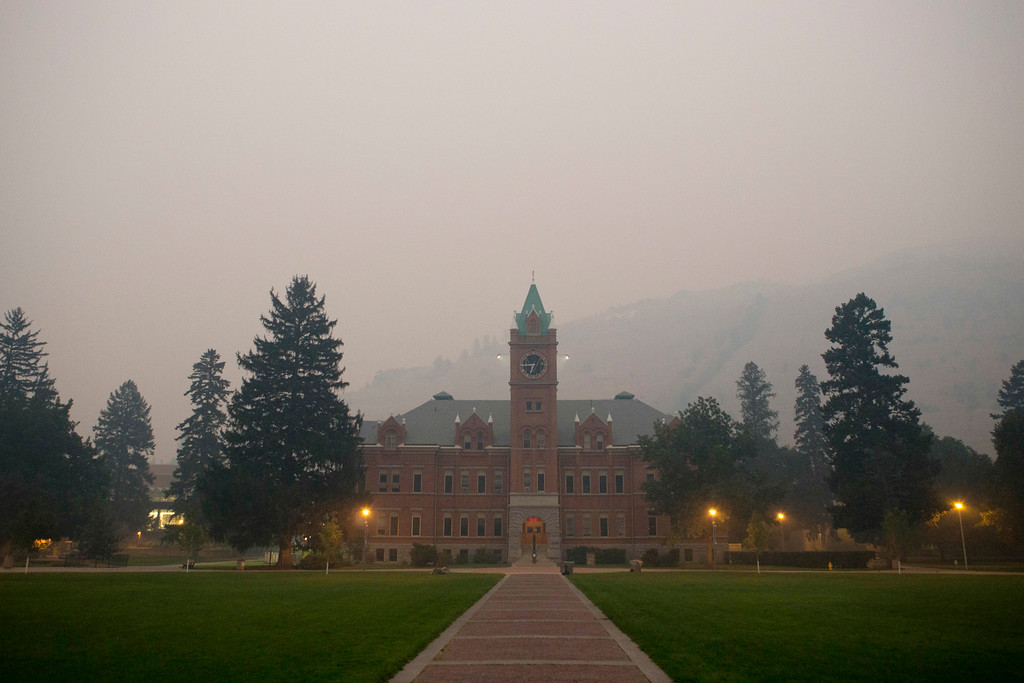 . Smoke from the nearby Lolo Peak Fire fills the air at the University of Montana in Missoula, Monday, Sept. 4, 2017. The air quality is has been measured at hazardous by the Montana Department of Environmental Quality. (AP Photo/Patrick Record)