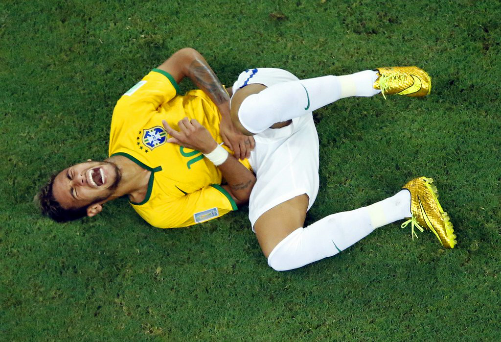 ". <p><b> Brazilian star Neymar was knocked out of the World Cup when he had a vertebrae broken by � </b> <p> A. Juan Camilo Zuniga�s knee <p> B. Arjen Robben�s foot <p> C. Luis Suarez�s bicuspids <p><b><a href=\'http://www.nytimes.com/2014/07/07/sports/worldcup/after-neymar-injury-brazil-seeks-punishment-for-zuniga.html?_r=0\' target=""_blank\"">LINK</a></b> <p>    (AP Photo/Fabrizio Bensch, pool)"