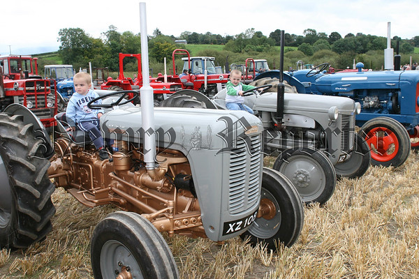 Two young boys enjoying the tractors at Bessbrook District Vintage Tractor Clubs Vintage Day in aid of the Southern area hospice services, 07W37N56
