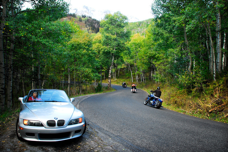 2011/10/10 – This is a cheat since I shot this image while on the Alpine loop yesterday, but I really liked the shot. I had gotten out of the car to try and shoot the sun flickering through the Aspen trees when this long line of motorcycles came cruising through the little S-turn we had stopped on. I found the image pleasing so it is today's photo.