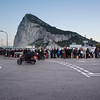 At approximately 1700hrs on the 23rd February 2014 the Spanish authorities tightened controls at the Gibraltar/Spain frontier creating up to two hour queues for pedestrians to cross into Spain. The extreme  increased controls, described by officials at the border as one of the worst in recent months, forced cross border workers and families to queue in a snake-like, zig-zag queue which filled the whole of the airport terminal car park and at one point reached the Sundial. The local authorities in Gibraltar increased their presence at the border, assisting vulnerable persons and families with children wishing to cross into Spain. The actions by the police were welcomed by those waiting who on seeing the police allow children by-pass the main bulk of the queues remained silent, even indicating other families which had been overlooked. At the time of Core Photography taking these images the police were revising their plans as the extend of the queues increased, seeking new areas to which they would have to divert pedestrians so as to reduce the pressure created within the airport terminal car park. Image depicts queues by the exit to Spain.