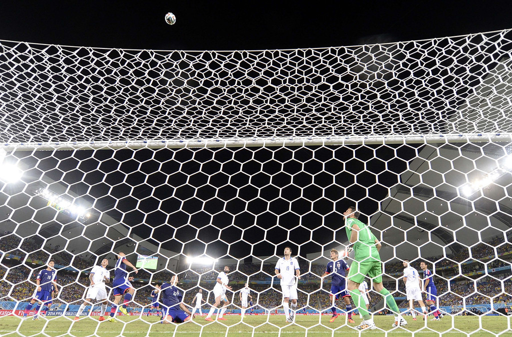. Greece\'s goalkeeper Orestis Karnezis eyes the ball during a Group C football match between Japan and Greece at the Dunas Arena in Natal during the 2014 FIFA World Cup on June 19, 2014. TOSHIFUMI KITAMURA/AFP/Getty Images