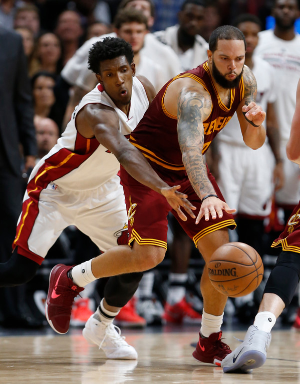 . Miami Heat guard Josh Richardson, left, attempts to steal the ball from Cleveland Cavaliers guard Deron Williams during the second half of an NBA basketball game, Monday, April 10, 2017, in Miami. The Heat defeated the Cavaliers 124-121 in overtime. (AP Photo/Wilfredo Lee)