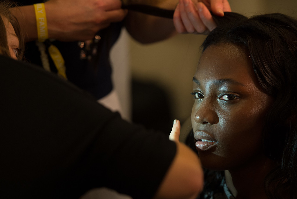 . A model prepares backstage at the Jonathan Saunders show during London Fashion Week Spring Summer 2015 on September 14, 2014 in London, England.  (Photo by Ian Gavan/Getty Images)