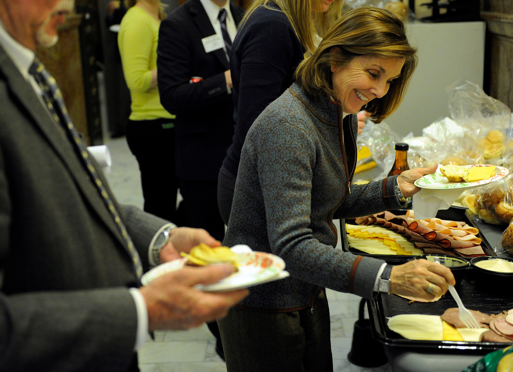 . DENVER, CO. - MARCH 8: State Senator Gail Schwartz (D-Snowmass) popped out of the Senate chambers long enough to grab a sandwich as debate continued on a bill that would limit high capacity magazines. The Colorado Senate continued to debate various gun control measures Friday night, March 8, 2013. (Photo By Karl Gehring/The Denver Post)