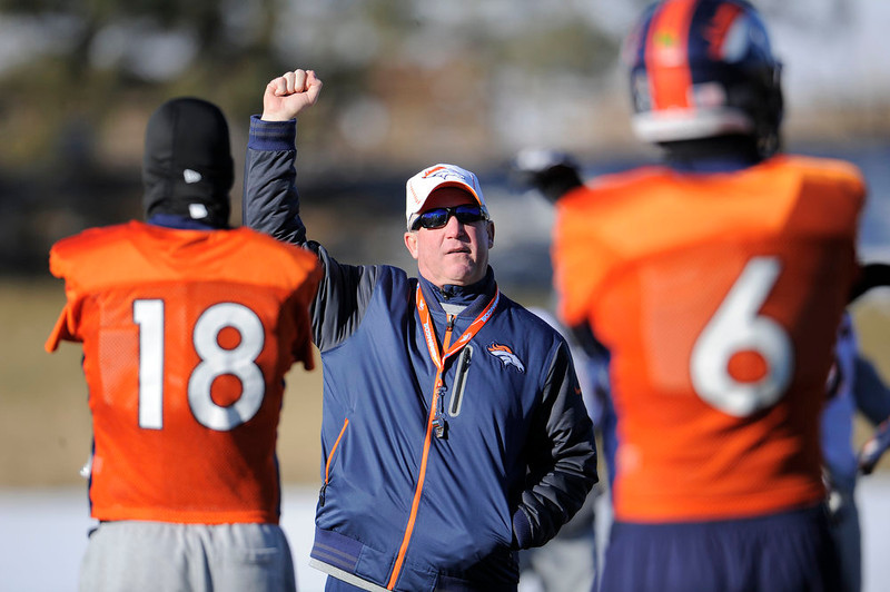 . Denver Broncos head coach John Fox talks with Peyton Manning during practice Thursday, January 3, 2013 at Dove Valley.  John Leyba, The Denver Post