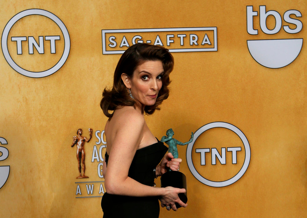 . Actress Tina Fey holds her award for outstanding performance by a female actor in a comedy series backstage at the 19th annual Screen Actors Guild Awards in Los Angeles, California January 27, 2013.   REUTERS/Adrees Latif
