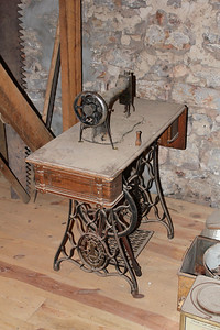 "This treadle sewing machine brings back memories of mending worn-out clothes, creating new ""fashions,"" and of rummaging through button boxes for just the right button!"