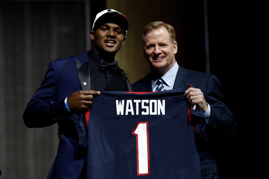 . Clemson\'s Deshaun Watson, left, poses with NFL commissioner Roger Goodell after being selected by the Houston Texans during the first round of the 2017 NFL football draft, Thursday, April 27, 2017, in Philadelphia. (AP Photo/Matt Rourke)