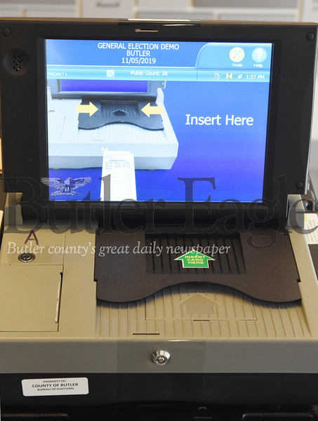 Harold Aughton/Butler Eagle: Butler County's new voting machines require the voter to scan their paper ballot.