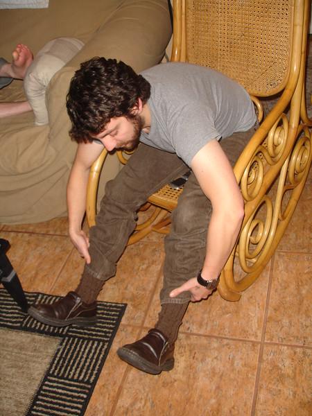 Andrs admires his socks