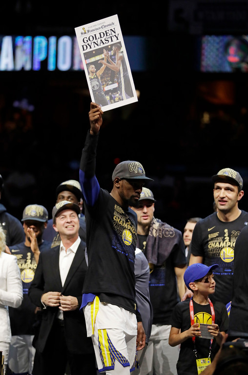 . Golden State Warriors\' Kevin Durant celebrates after the Warriors defeated the Cleveland Cavaliers 108-85 in Game 4 of basketball\'s NBA Finals to win the NBA championship, Friday, June 8, 2018, in Cleveland. (AP Photo/Tony Dejak)