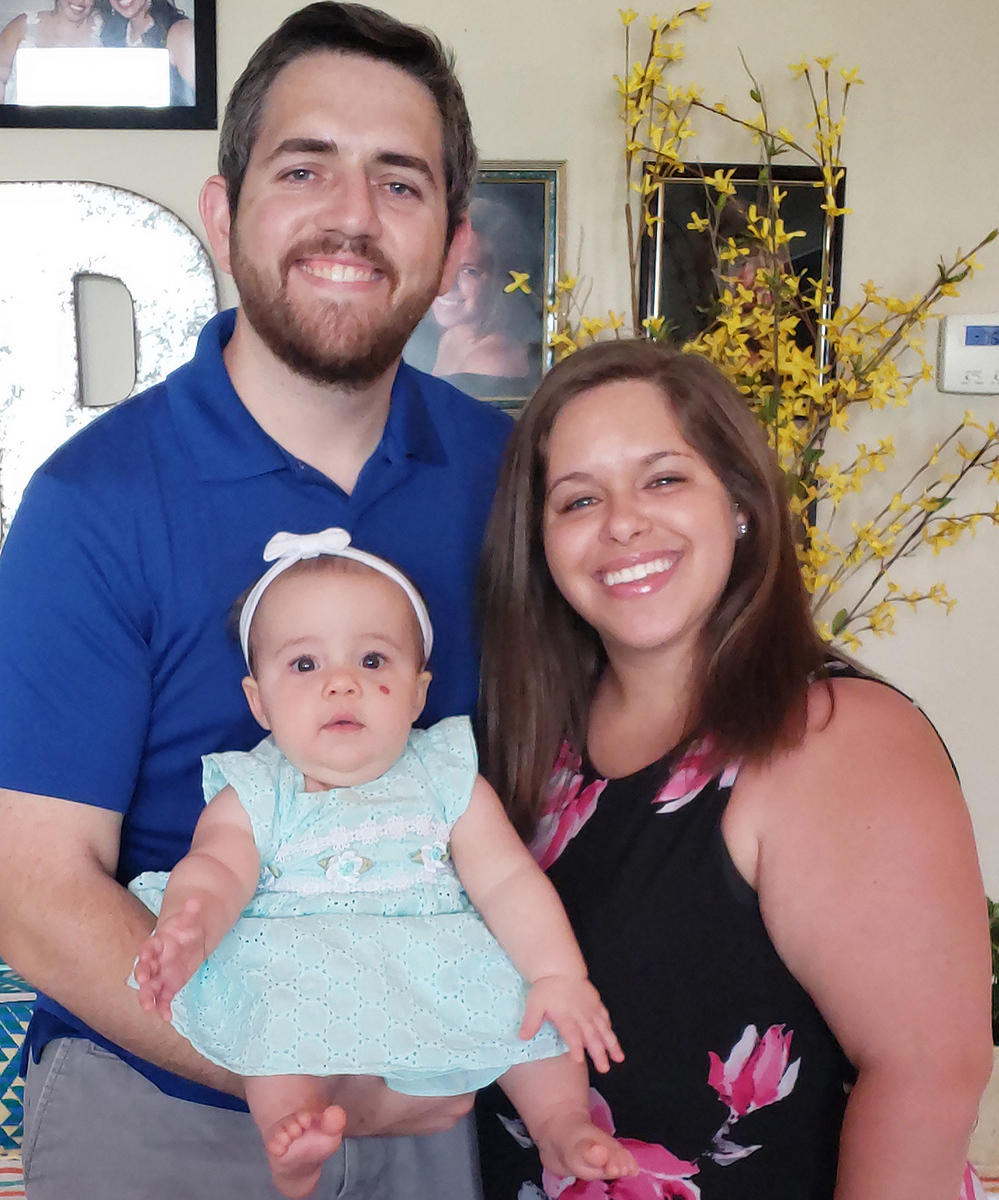 Sergeant Douglas Payne with his wife, Melissa, and their baby, Grace.