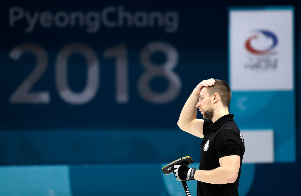 . Russian athletes Aleksandr Krushelnitckii react during their mixed doubles curling semi-final match against Switzerland at the 2018 Winter Olympics in Gangneung, South Korea, Monday, Feb. 12, 2018. Switzerland won. (AP Photo/Aaron Favila)