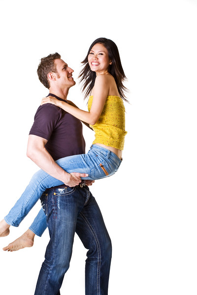 caucasian man carrying his girlfriend