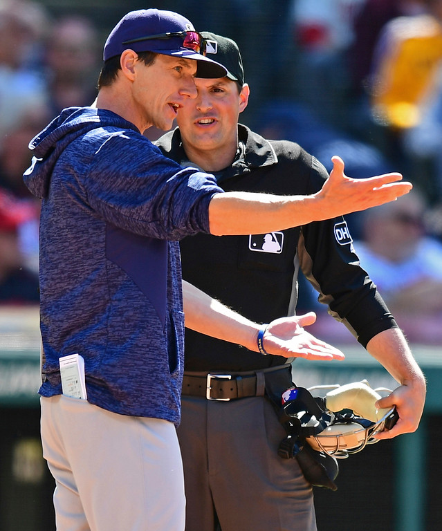 . Home plate umpire Quinn Wolcott, right, argues with Milwaukee Brewers manager Craig Consell after Councell was ejected in the eighth inning of a baseball game against the Cleveland Indians, Wednesday, June 6, 2018, in Cleveland. The Indians won 3-1. (AP Photo/David Dermer)
