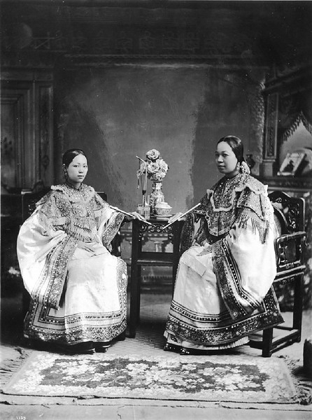 Chinese young women in fine clothing, ca.1900