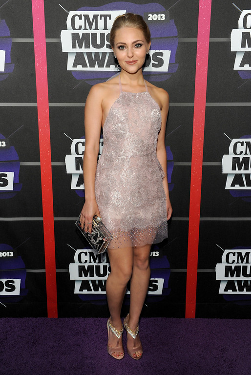. Actress AnnaSophia Robb arrives at the 2013 CMT Music Awards at Bridgestone Arena on Wednesday, June 5, 2013, in Nashville, Tenn. (Photo by Frank Micelotta/Invision/AP)