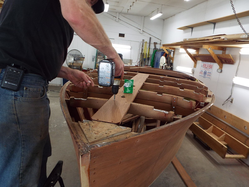 New king plank being glued in place.