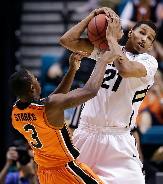. Colorado\'s Andre Roberson (21) battles for a loose ball against Oregon State\'s Ahmad Starks (3) in the first half of a Pac-12 tournament NCAA college basketball game, Wednesday, March 13, 2013, in Las Vegas. (AP Photo/Julie Jacobson)