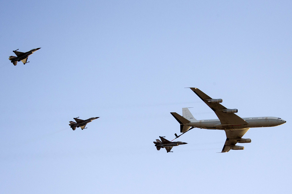 . An Israeli F-16 fighter jet is refueled by a Boeing 707 during an air show at the graduation ceremony of Israeli pilots in the Hatzerim air force base in the southern Negev desert, near the southern Israeli city of Beersheva on December 26, 2013. AFP PHOTO / JACK GUEZ/AFP/Getty Images