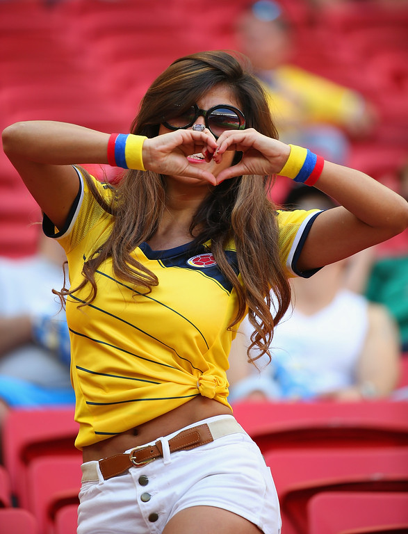 . A Colombia fan enjoys the atmosphere prior to the 2014 FIFA World Cup Brazil Group C match between Colombia and Cote D\'Ivoire at Estadio Nacional on June 19, 2014 in Brasilia, Brazil.  (Photo by Gabriel Rossi/Getty Images)