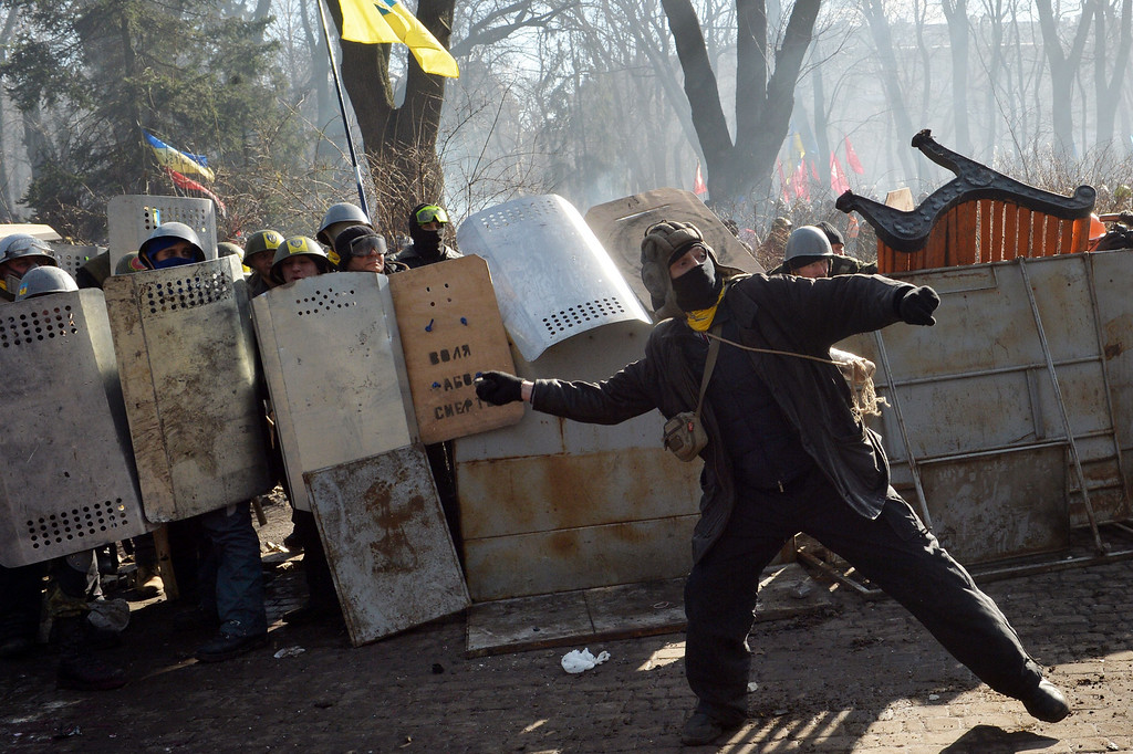 . Anti-government protesters clash with police in front of the Ukrainian Parliament in Kiev on February 18, 2014.  AFP PHOTO/ SERGEI SUPINSKY/AFP/Getty Images